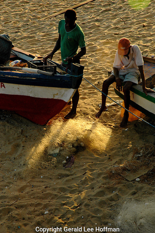 End of the Day Fishermen on Rio Vermelho beach, Salvador, Brazil.