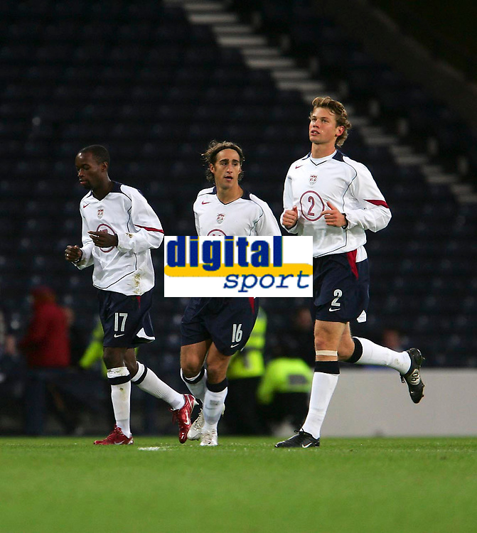 Photo: Andrew Unwin.<br />Scotland v USA. International Challenge. 12/11/2005.<br />The USA's Joshua Wolff (C) celebrates his early goal with DaMarcus Beasley (L) and Jonathan Spector (R).