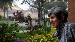 Nereida Lezcano says she has never seen anything like this as she looks outside as Hurricane Irma's bands cause downed trees and damage in the area in The Vineyards in Monarch Lakes in Miramar Sunday afternoon, September 10, 2017. Photo by Taimy Alvarez/Sun Sentinel/TNS/ABACAPRESS.COM