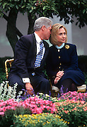 US President Bill Clinton whispers to first lady Hillary Clinton during an event at the White House March 22, 1997 in Washington, DC.