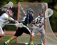 7 MAY 2009 -- CREVE COEUR, Mo. -- St. Louis University High School lacrosse player Michael Griffard (25) launches a shot on DeSmet Jesuit High School goalie Ben Besancenez (33) despite pressure from Michael Rehme (9) during second half of the 7th annual Father Marco Cup at DeSmet in Creve Coeur, Mo. Saturday, May 7, 2011. SLUH topped DeSmet 13-10 in the annual game. Image © copyright 2011 Sid Hastings.