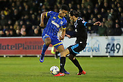 AFC Wimbledon striker Lyle Taylor (33) and Portsmouth defender Christian Burgess (6) compete during the Sky Bet League 2 match between AFC Wimbledon and Portsmouth at the Cherry Red Records Stadium, Kingston, England on 26 April 2016.