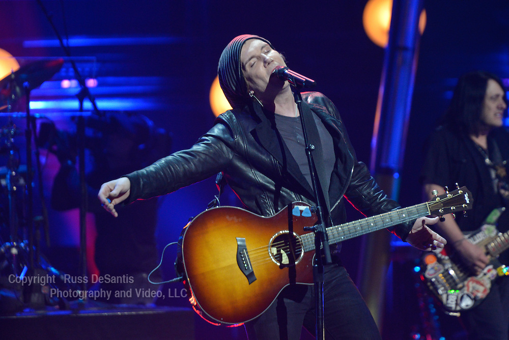 The Goo Goo Dolls performed at the St. George Theatre in Staten Island, NY, on Friday, January, 31, 2014. John Rzeznik sings and plays guitar./ Russ DeSantis/AP Images for the NFL