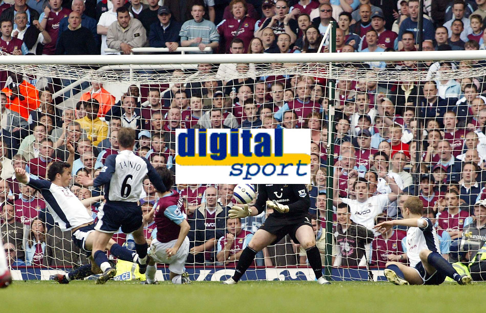 Photo: Chris Ratcliffe.<br /> West Ham United v Tottenham Hotspur. The Barclays Premiership. 07/05/2006.<br /> Yossi Benayoun of  West Ham clips the ball past Paul Robinson in the Spurs goal for the winning goal and break Spurs hearts.