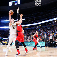 09 April 2018: Denver Nuggets center Nikola Jokic (15) goes for the layup past Portland Trail Blazers center Jusuf Nurkic (27) during the Denver Nuggets 88-82 victory over the Portland Trail Blazers, at the Pepsi Center, Denver, Colorado, USA.