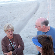 Volunteer Linda Osowski, left talks to Bob and Jan Burns at a Sea Turtle nest in Carolina Beach, N.C. (Jason A. Frizzelle)