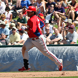 March 13, 2011; Fort Myers, FL, USA; Philadelphia Phillies left fielder Delwyn Young (24) runs the bases after hitting a three run homeun during a spring training exhibition game against the Minnesota Twins at Hammond Stadium.   Mandatory Credit: Derick E. Hingle