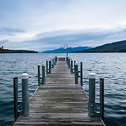 Cloudy skies on a dock on Lake George in the Adirondacks, Upstate New York.