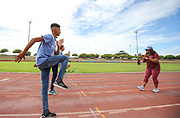 Mar 10, 2018; Cape town, South Africa; Coach Sharrieffa Barksdale of the USA (1984 Los Angeles Olympic Games 400m hurdles gold medal winner) showing young athletes some drills during the TrackGirlz events at University of Western Cape on March 10, 2018 in Cape Town, South Africa. (Roger Sedres/Image of Sport)