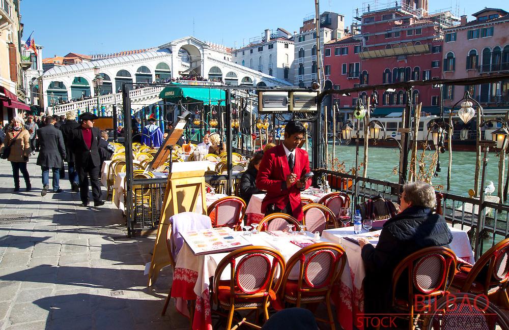 Restaurant, Grand Canal and Rialto Bridge. Venice, Italy.