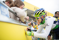 Loren Rowney (AUS) of Orica-AIS Cycling Team signs autographs before the start of the Aviva Women's Tour 2016 - Stage 4. A 119.2 km road race from Nottingham to Stoke-on-Trent, UK on June 18th 2016.