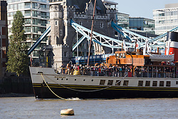 © Licensed to London News Pictures. 30/09/2016. LONDON, UK.  Tourists enjoy the sunny autumn weather on Paddle Steamer Waverley (PS Waverley) as she passes under raised Tower Bridge on the River Thames this morning. The Waverley, built in the Clyde, Scotland in 1956, is the world's last remaining seagoing paddle steamer in the world and is visiting London for her 70th anniversary since she was first launched. Photo credit: Vickie Flores/LNP