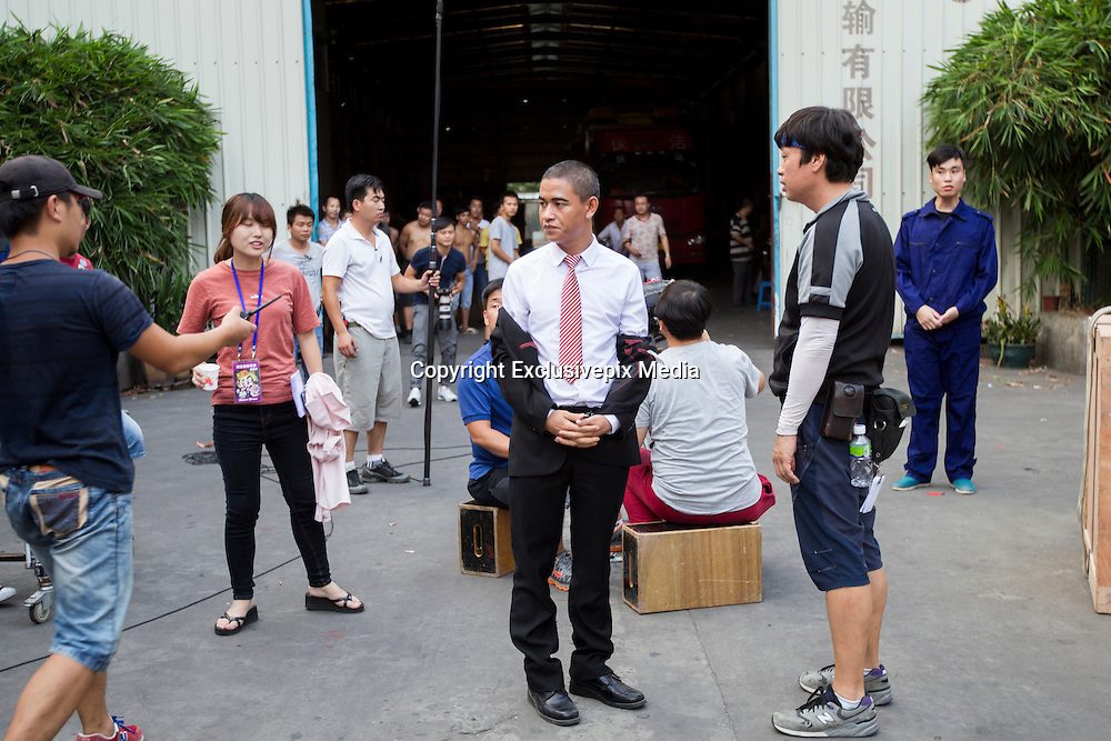 GUANGZHOU, CHINA - OCTOBER 02: (CHINA OUT)<br /> <br /> Chinese Obama Imitator<br /> <br /> Xiao Jiguo (C) who is famous for imitating American President Obama rests after shooting a scene of a comedy at a warehouse on October 2, 2015 in Guangzhou, China. Xiao Jiguo, born in Sichuan province, was well-known as an imitator of American President Barack Hussein Obama after acting in a Chinese entertainment program. He became a star among the commercial events and acted in a comedy during the Chinas National Day Holiday in Guangzhou.<br /> ©Exclusivepix Media