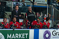 KELOWNA, CANADA - APRIL 7: Portland Winterhawks' assistant coach, Kyle Gustafson and equipment manager Mark Brennan stand on the bench against the Kelowna Rockets on April 7, 2017 at Prospera Place in Kelowna, British Columbia, Canada.  (Photo by Marissa Baecker/Shoot the Breeze)  *** Local Caption ***