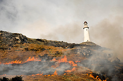 (c) Licenced to London News Pictures 19/03/2015. Ulverston, Cumbria, UK. The vegetation on Hoad Hill around the Sir John Barrow Monument in Ulverston is burned off in a controlled blaze. This is to prevent sheep and cattle getting caught and stuck in the overgrown bracken and heather. Photo credit : Harry Atkinson/LNP