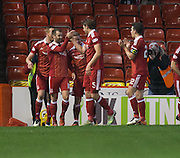 Aberdeen&rsquo;s Niall McGinn is congratulated after scoring  - Aberdeen v Dundee in the Ladbrokes Scottish Premiership at Pittodrie, Aberdeen - Photo: David Young, <br /> <br />  - &copy; David Young - www.davidyoungphoto.co.uk - email: davidyoungphoto@gmail.com