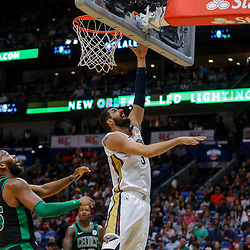 Mar 18, 2018; New Orleans, LA, USA; New Orleans Pelicans forward Nikola Mirotic (3) shoots over Boston Celtics center Greg Monroe (55) during the first quarter at the Smoothie King Center. Mandatory Credit: Derick E. Hingle-USA TODAY Sports