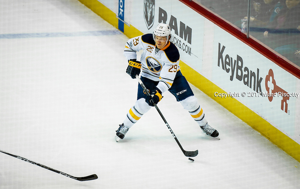 SHOT 2/25/17 10:19:11 PM - The Buffalo Sabres' Jake McCabe #29 looks to pass to a teammate against the Colorado Avalanche during their NHL regular season game at the Pepsi Center in Denver, Co. The Avalanche won the game 5-3. (Photo by Marc Piscotty / © 2017)