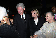 l to r: Former President Bill Clinton, U.S.Secretary of State Hillary Clinton and Susan Tatum at The Amsterdam News 100th Anniversary Gala held at the David H. Koch Theater at Lincoln Center on November 30, 2009 in New York City. © Terrance Jennings / Retna Ltd.