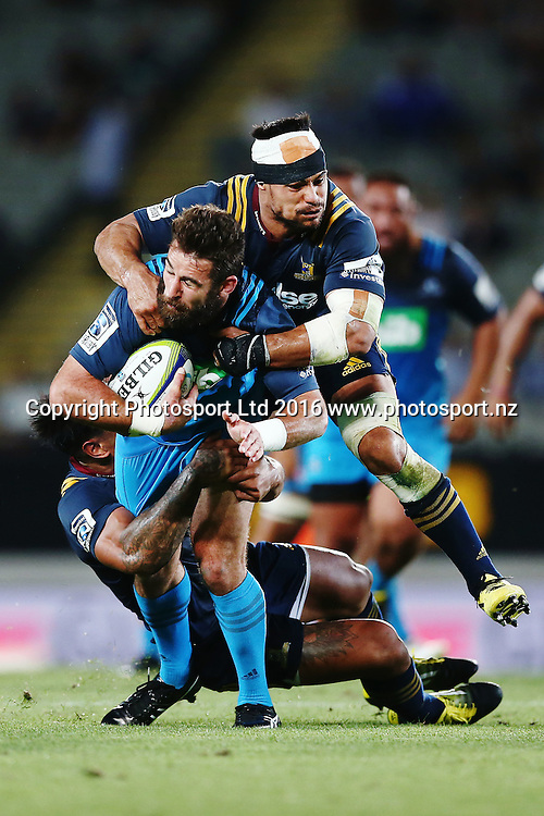 Billy Guyton of the Blues is tackled by Shane Christie of the Highlanders. Super Rugby match, Blues v Highlanders at Eden Park, Auckland, New Zealand. 26 February 2016. Photo: Anthony Au-Yeung / www.photosport.nz
