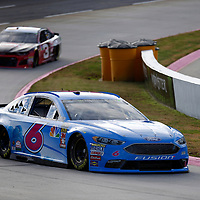 Matt Kenseth (6) races through turn three to practice  for the First Data 500 at Martinsville Speedway in Martinsville, Virginia.