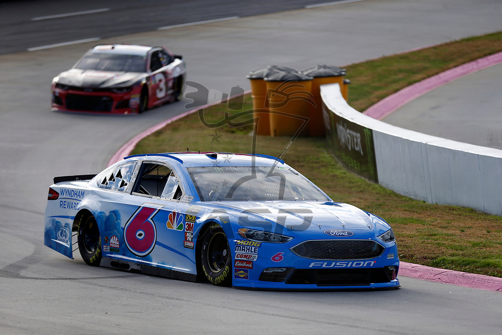 Matt Kenseth (6) races through turn three to practice  for the First Data 500 at Martinsville Speedway in Martinsville, Virginia.