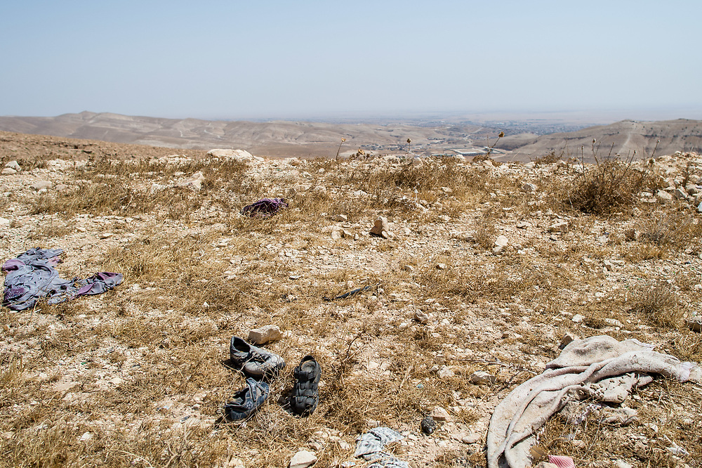 Clothes lies in Shingal mountains. It was left behind by Ezidi people fleeing to the mountains when ISIS overran the area on August 3, 2014. Shingal (Sinjar), Iraq, September 8, 2015