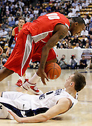 BYU guard Kyle Collinsworth, bottom, falls to the court as New Mexico forward A.J. Hardeman, top, steals the ball during the second half of an NCAA college basketball game in Provo, Utah, Wednesday, March. 2, 2011. New Mexico defeated third-ranked BYU, 82-64.(AP Photo/Colin E Braley)