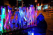 A light vendor at City Hall during New Year's Eve in Austin Texas as part of the First Night 2010 celebration, December 31, 2009