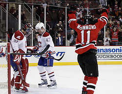 Dec 16, 2009; Newark, NJ, USA; New Jersey Devils left wing Dean McAmmond (11) celebrates the first NHL goal by New Jersey Devils right wing Ilkka Pikkarainen (17) during the second period at the Prudential Center.