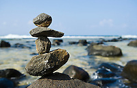 Rock stack on shore near Moloa'a bay, Kauai, Hawaii, USA.