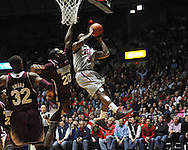 "Ole Miss' Murphy Holloway (31) is fouled by Mississippi State's Gavin Ware (20) at the C.M. ""Tad"" Smith Coliseum on Wednesday, February 6, 2013. (AP Photo/Oxford Eagle, Bruce Newman).."