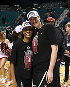Stanford Cardinal guard Kiana Williams (23) and Stanford Cardinal center Shannon Coffee (2)  pose for a picture after winning the championship game of the Pac-12 Conference women's basketball tournament Sunday, Mar. 10, 2019 in Las Vegas.  Stanford defeated Oregon 64-57. (Gerome Wright/Image of Sport)