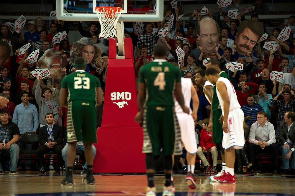 DALLAS, TX - JANUARY 15: SMU Mustangs fans wave signs while Chris Perry #23 of the South Florida Bulls attempts a free-throw on January 15, 2014 at Moody Coliseum in Dallas, Texas.  (Photo by Cooper Neill/Getty Images) *** Local Caption ***