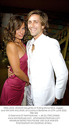 MISS JADE JAGGER daughter of Rolling Stone Mick Jagger, and MR DAN WILLIAMS, at a party in Berkshire on 27th June 2002.PBK 322