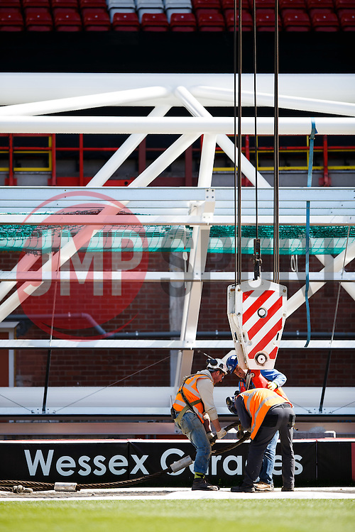 The huge steel truss that forms the Dolman Stand Roof Extension is hoisted into place as part of redevelopment works at Ashton Gate - Photo mandatory by-line: Rogan Thomson/JMP - Mobile: 07966 386802 - 29/04/2015 - SPORT - Bristol, England - Ashton Gate Stadium.