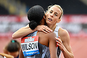 Lynsey Sharp (GBR), right, congratulates Ajee Wilson (USA) after Wilson won the women 800m in a time of 2.00.76 during the Birmingham Grand Prix, Sunday, Aug 18, 2019, in Birmingham, United Kingdom. (Steve Flynn/Image of Sport via AP)