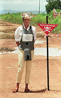 Diana, Princess of Wales, walks with body armour and a visor on the minefields during a visit to Angola in January 1997..