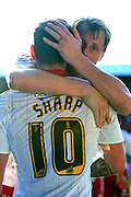 Sheffield United defender James McEveley (19) hugs Sheffield United forward Billy Sharp (10) after he scored to go 3-2 up and win the match  during the Sky Bet League 1 match between Sheffield Utd and Crewe Alexandra at Bramall Lane, Sheffield, England on 25 March 2016. Photo by Ian Lyall.