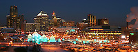 The Winter Carnival Ice Castle stands in the foreground of the St. Paul skyline.  St. Paul, Minnesota, USA.