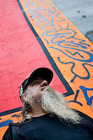"2 August, 2008. New York, NY. Clayton Patterson, a gallerist and artist born in 1948, is here in front of the mural the graffiti artist Angel Ortiz and him tagged on July 22nd 2008.  Mr Patterson helped Mr Ortiz to tag the wall. Angel Ortiz tagged his nickname ""LA2"", which refers to ""Little Angel"", on the Keith Haring mural that was reproduced on May 4th 2008, after the original 1982 graffiti was painted over. Mr. Ortiz has accused the Haring Foundation of denying him credit on many of the jointly produced works.  The two artists met in 1980, when Angel Ortiz was 13 years old. Subsequently, Ortiz and Haring collaborated for several years and had joint shows. <br />  ©2008 Gianni Cipriano for The New York Times<br /> cell. +1 646 465 2168 (USA)<br /> cell. +1 328 567 7923 (Italy)<br /> gianni@giannicipriano.com<br /> www.giannicipriano.com"
