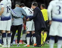 Football - 2018 / 2019 UEFA Champions League - Semi-Final, First Leg: Tottenham Hotspur vs. Ajax<br /> <br /> Spurs, Jan Verttonghen is helped off the pitch by Manager, Mauricio Pochettino after being hit in the face, at The Tottenham Hotspur Stadium.<br /> <br /> COLORSPORT/ANDREW COWIE