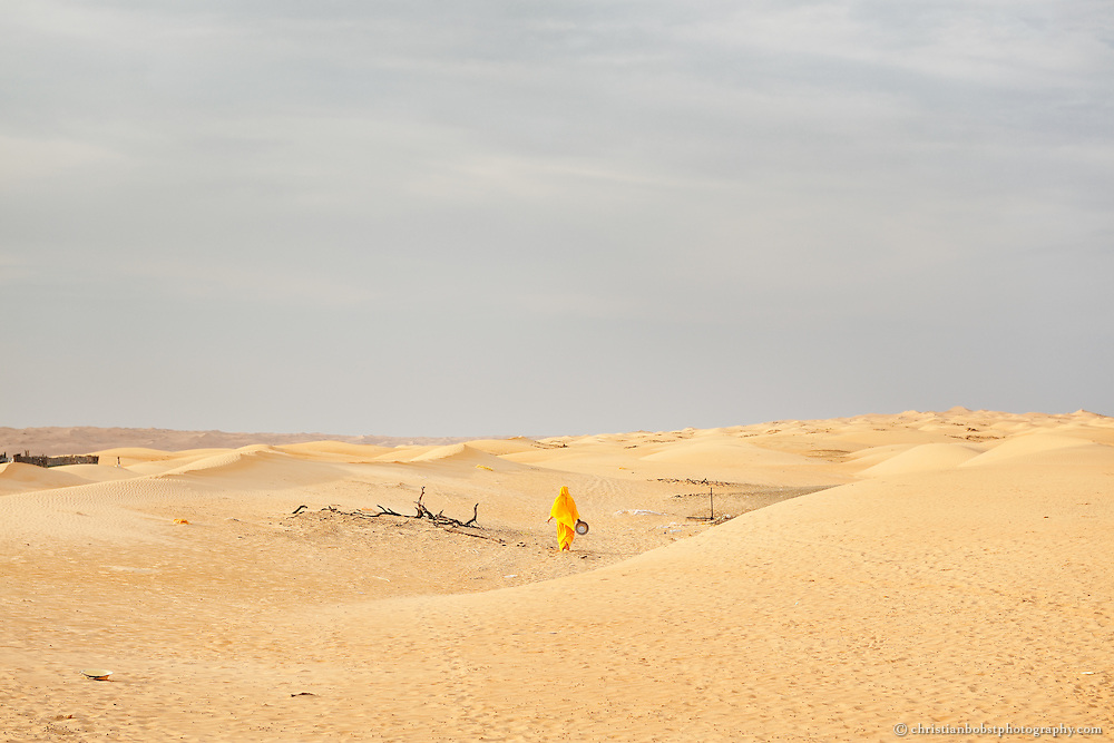 A Beduin woman in the desert of Wahiba Sands. Oman, 2011