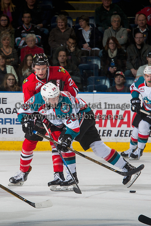 KELOWNA, CANADA - JANUARY 21: Brendan De Jong #21 of the Portland Winterhawks checks Conner Bruggen-Cate #20 of the Kelowna Rockets during first period on January 21, 2017 at Prospera Place in Kelowna, British Columbia, Canada.  (Photo by Marissa Baecker/Shoot the Breeze)  *** Local Caption ***