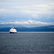 A cruise ship in the Beagle Channel en route to Antarctica. The snow-capped mountains in the distance are across the Beagle Channel in Chile.