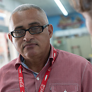 OCTOBER 18 - LARES, PUERTO RICO - <br /> Jose Mendez, manager at Mr. Special Supermarket in Lares, talks about the customer shopping needs to Mercy Corps staffers following the destructive path of hurricane Maria.<br /> (Photo by Angel Valentin for NPR)