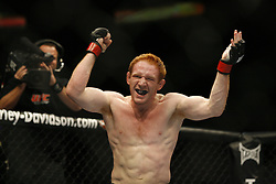 Apr 18, 2009; Montreal, Quebec, CAN; Mark Bocek (navy/white) and David Bielkheden (black/white) battle during their lightweight bout at UFC 97: Redemption at the Bell Centre in Montreal, Canada.  Bocek won via rear-naked choke in the first round.