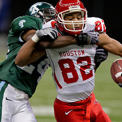 Oct 17, 2009; New Orleans, LA, USA; Tulane Green Wave safety Chinonso Echebelem (24) tackles Houston Cougars wide receiver Chaz Rodriguez (82) during the first half at the Louisiana Superdome. Mandatory Credit: Derick E. Hingle-US PRESSWIRE