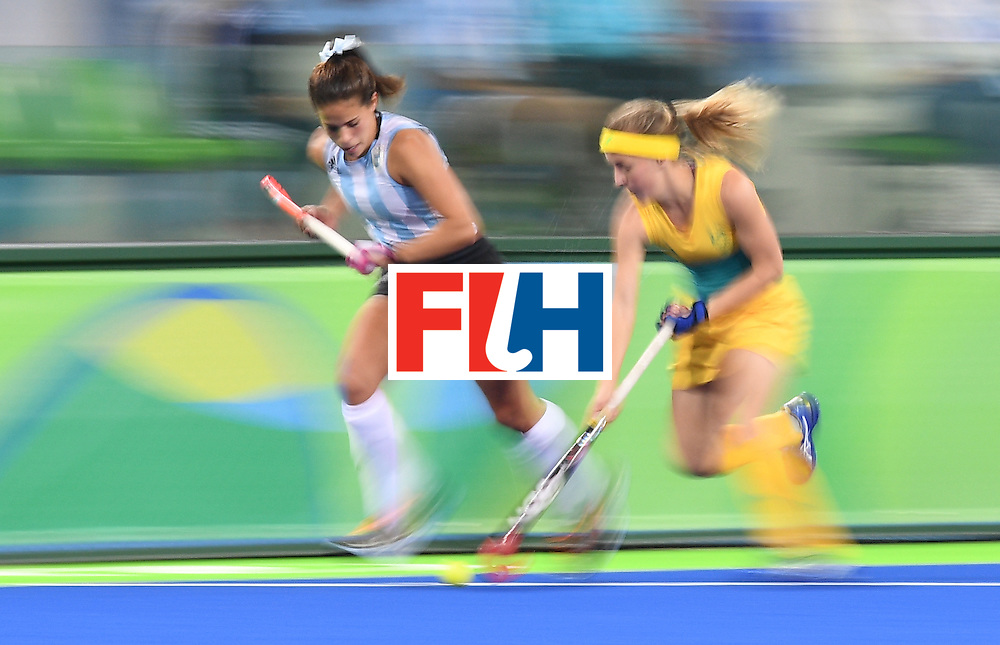 Argentina's Lucina von der Heyde (L) and Australia's Emily Smith chase the ball during the women's field hockey Australia vs Argentina match of the Rio 2016 Olympics Games at the Olympic Hockey Centre in Rio de Janeiro on August, 11 2016. / AFP / MANAN VATSYAYANA        (Photo credit should read MANAN VATSYAYANA/AFP/Getty Images)
