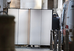 © Licensed to London News Pictures. 07/02/2018. London, UK. A screen is put up to prevent media seeing JOHN WORBOYS (pictured right) as he leaves the High Court in London where two of his victims challenged a decision to release the black cab rapist from prison. London Mayor Sadiq Khan will also urge Sir Brian Leveson and Mr Justice Garnham to allow judicial review action against the Parole Board. Photo credit: Ben Cawthra/LNP
